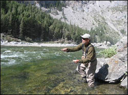"Angler casting in ""The Gap"" section of the Oldman"